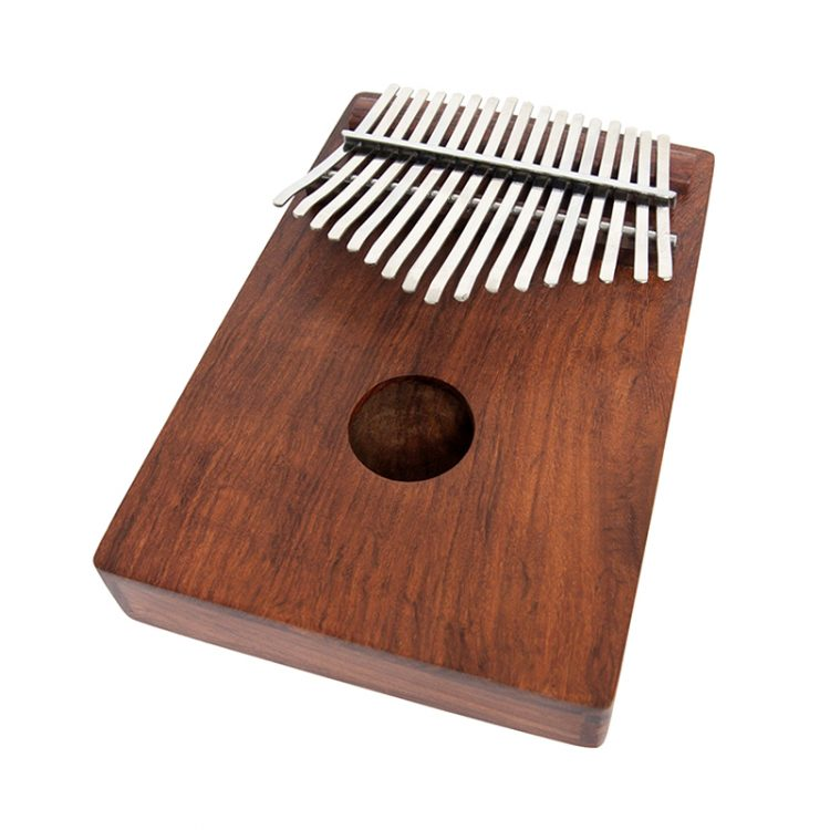 To play, rest the rosewood thumb piano on the fingers of both hands and hold it between your palms